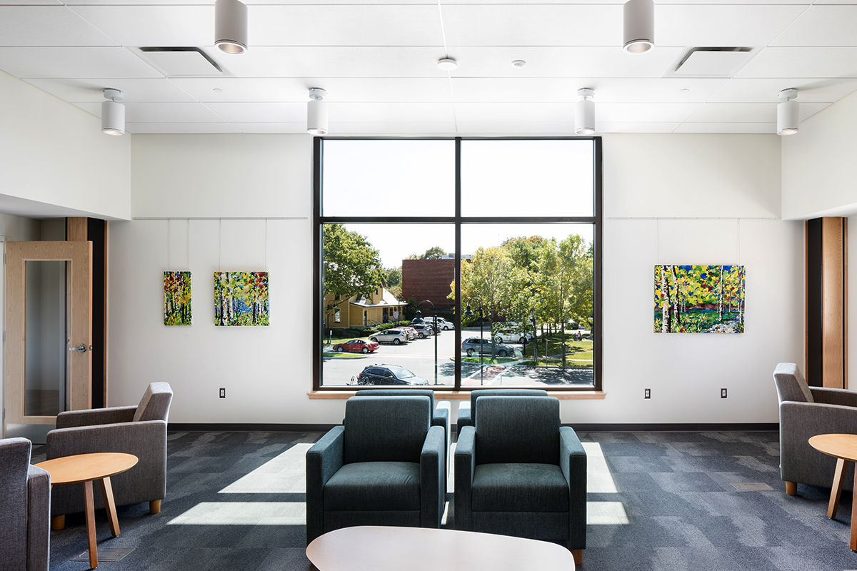 Pierson Library reading area with large window and artwork by local area artists